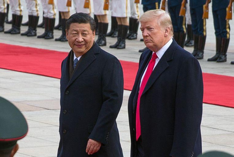Archiefbeeld - De Chinese president Xi Jinping (l.) en zijn Amerikaanse ambtsgenoot Donald Trump (r.)