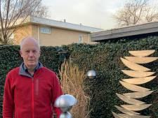 André is trots op zijn tuin die opgaat in het achtergelegen duinlandschap