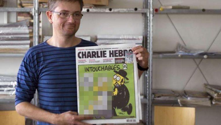 Wat nu precies zo schokkend is aan de cartoons van Charlie Hebdo, blijft onzichtbaar voor de lezers van The New York Daily News. Beeld NFP/New York Daily News