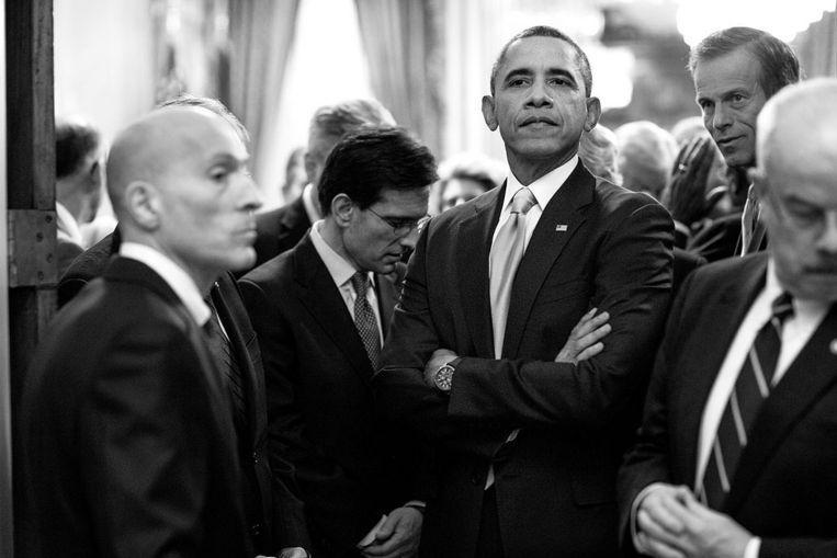 President Obama wacht, omgeven door zijn beveiligers, in het Congres om zijn jaarlijkse State of the Union te geven Beeld White House Photo