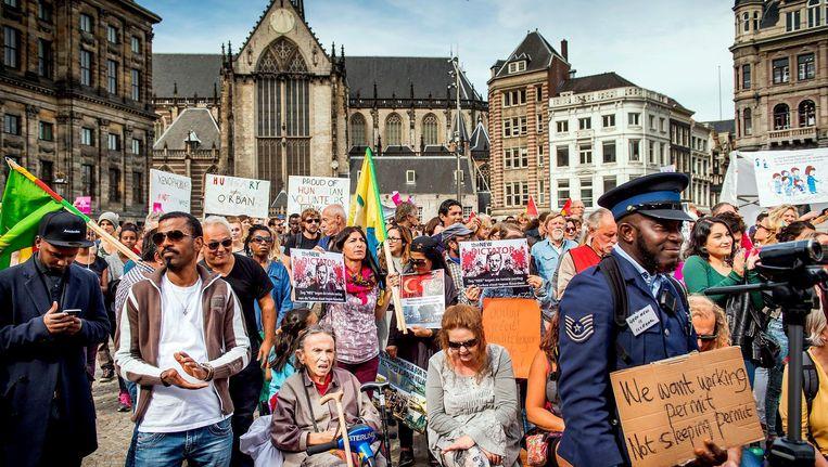 Demonstranten op de Dam in Amsterdam. Beeld anp