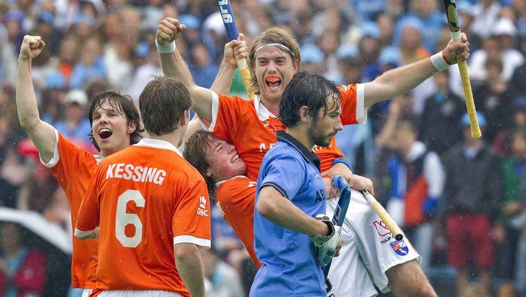 Kessing met nummer 6, Meijer uiterst rechts in het oranje. Beeld anp