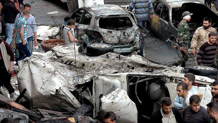 Ravage na een aanslag in Homs. Beeld epa
