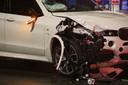 De zwaarbeschadigde BMW na de aanrijding.