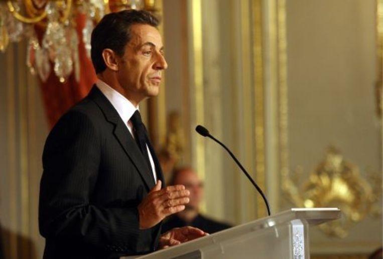 Sarkozy behoort tot een van de zogeheten 'muurspechten'. ANP Beeld