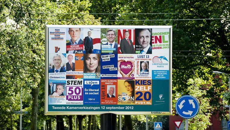 De verkiezingsposters van 2012, toen nog met LibDem (lijst 17). Beeld anp