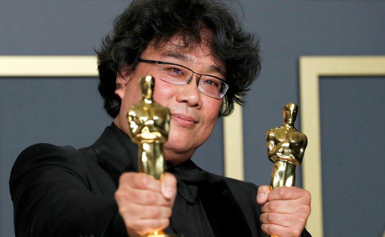 De Koreaanse regisseur Bong Joon Ho won dit jaar twee Oscars voor Parasite, een satirische film over de toenemende klassenverschillen  in zijn land. Beeld REUTERS