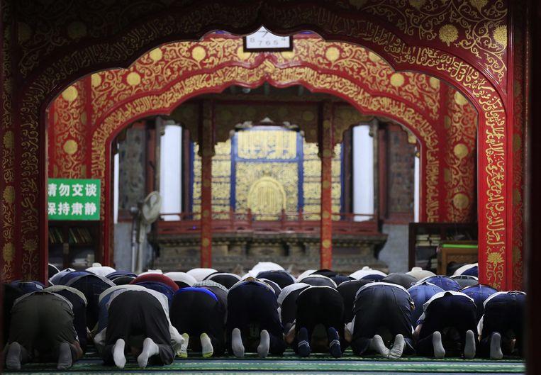 Mannen bidden allemaal op hetzelfde ritme, in tegenstelling tot de vrouwen Beeld epa