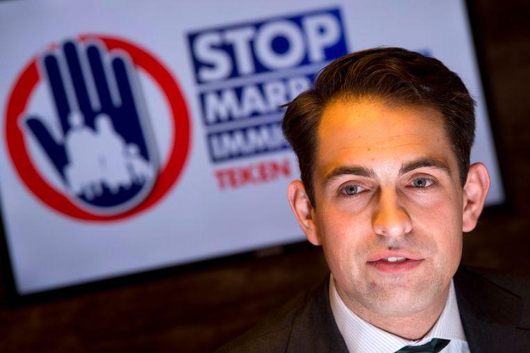 Vlaams Belang-voorzitter Tom Van Grieken tijdens de persvoorstelling van de campagne 'Stop Marrakesh immigratiepact'.