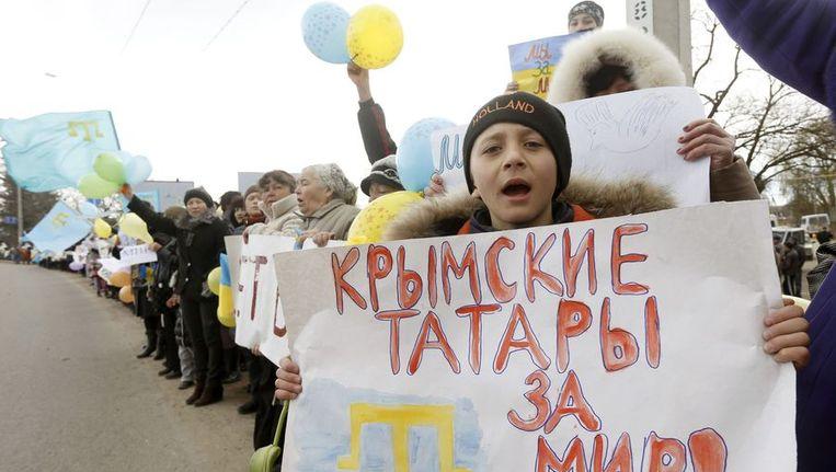 Anti-oorlogsdemonstratie in het dorp Eskisaray, vlakbij Simferopol op de Krim. Beeld reuters
