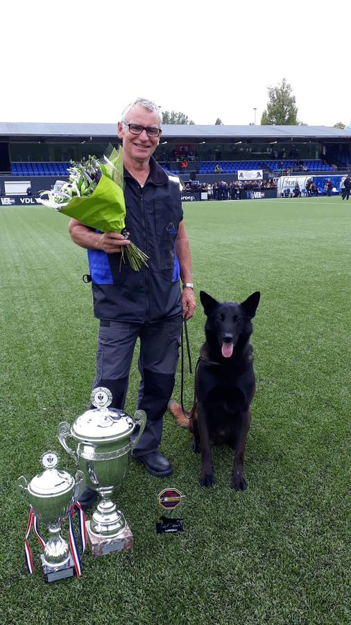 Het winnende duo: Peter van Oorschot met zijn hond Shadow.
