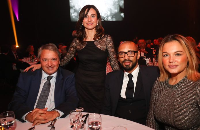 Anderlecht's manager Herman Van Holsbeeck and her wife Esmeralada and Anderlecht's team manager Gunther Van Handenhoven pictured during the fifth edition of the Gala evening 'Sport and Fashion evening', a charity gala for associations, organised by Carlo & Fils, at the Spiroudome in Charleroi with Miss Belgium candidates and players of Sporting Charleroi, Monday 20 November 2017. BELGA PHOTO VIRGINIE LEFOUR