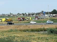 Auto in sloot beland op A2 bij Culemborg