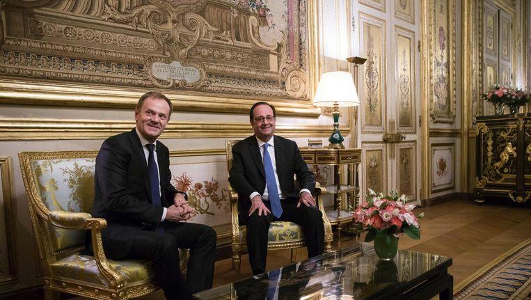 EU-president Donald Tusk - links - op bezoek in het Elysée bij de Franse president Hollande, 31 januari. Beeld afp