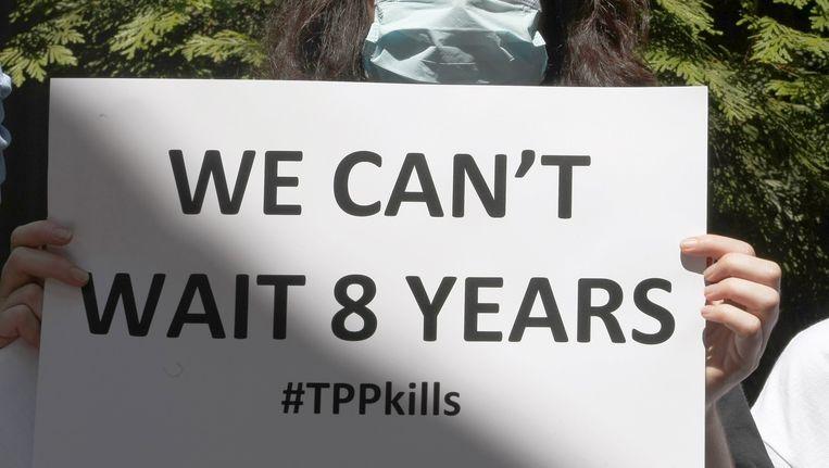 Niet iedereen is het eens met de komst van het TPP-akkoord. Deze vrouw demonstreert ertegen in Atlanta. Beeld Reuters