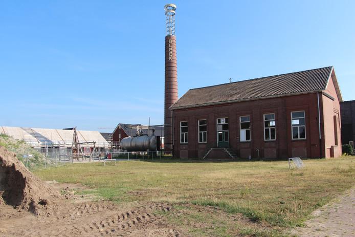 De groene ruimte voor het ketelhuis in de wijk Op de Bleek wordt bij de afronding van de wijk volgebouwd met 7 'grondgebonden' woningen.