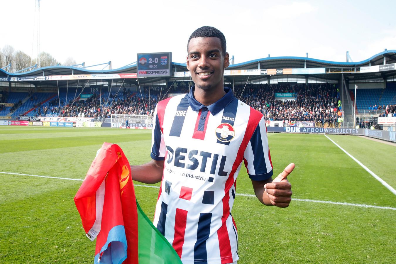 Isak met de vlag van Eritrea.