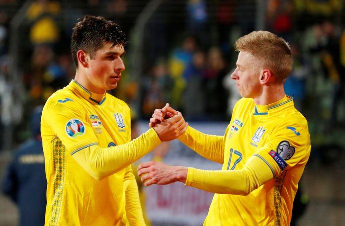 Ruslan Malinovsky (l) en  Oleksandr Zinchenko.
