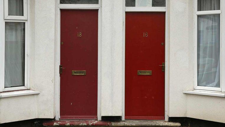 De bewuste rode voordeuren. Beeld Reuters