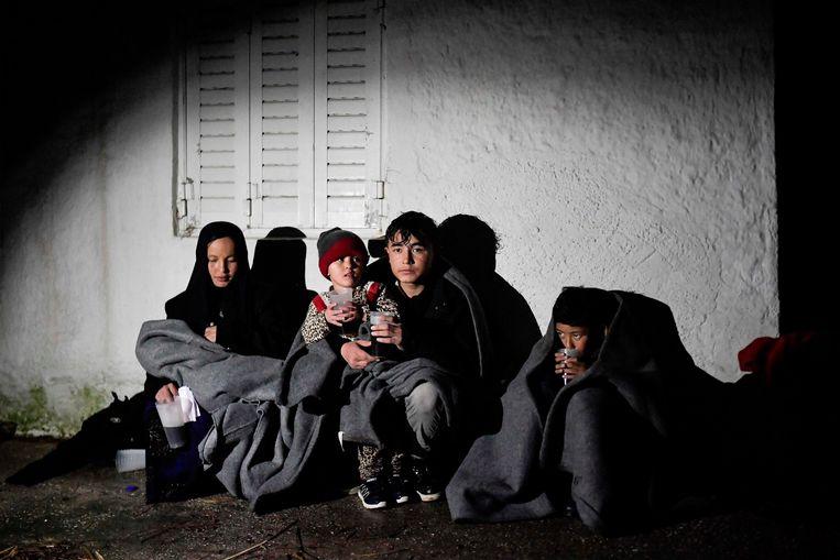 Vluchtelingen vlak na aankomst op Lesbos in maart dit jaar. Beeld AFP