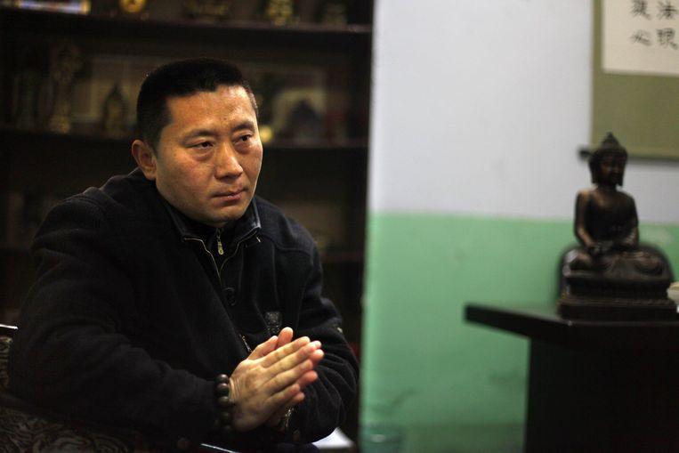 Twintig jaar geleden schoot hij op de studenten van het Plein van de Hemelse Vrede, nu kiest hij de zijde van die studenten: Zhang Shijun. Foto GPD/AP Beeld
