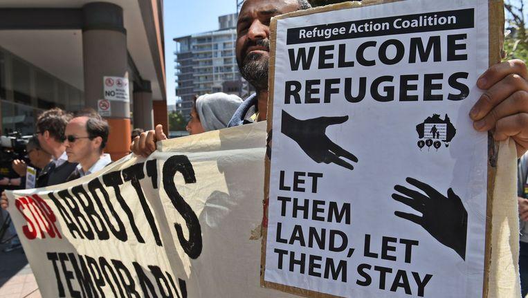 Protesten in Sydney tegen het plan om vluchtelingen van Australië naar Cambodja over te brengen. Beeld afp
