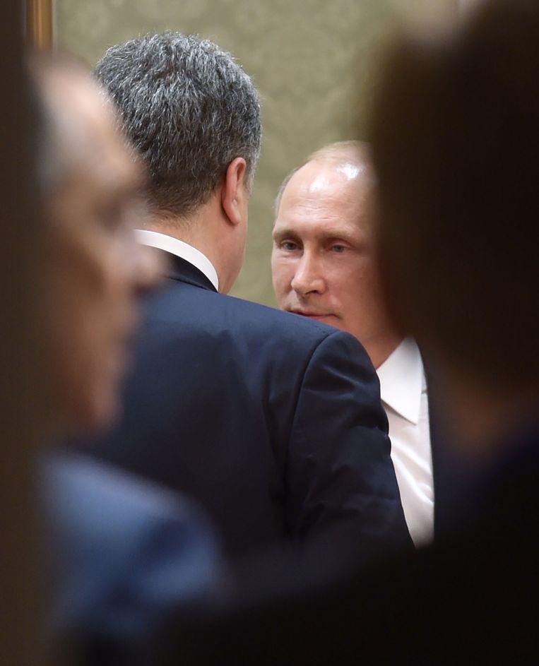 Poetin in overleg met Porosjenko.