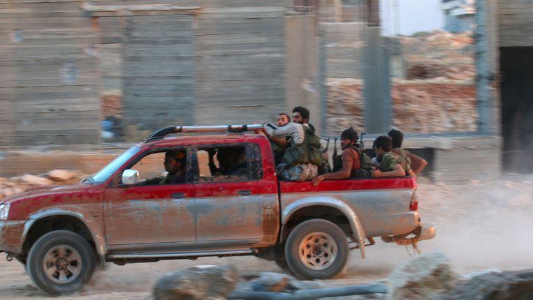 Strijders van het Syrische veroveringsleger in Aleppo.