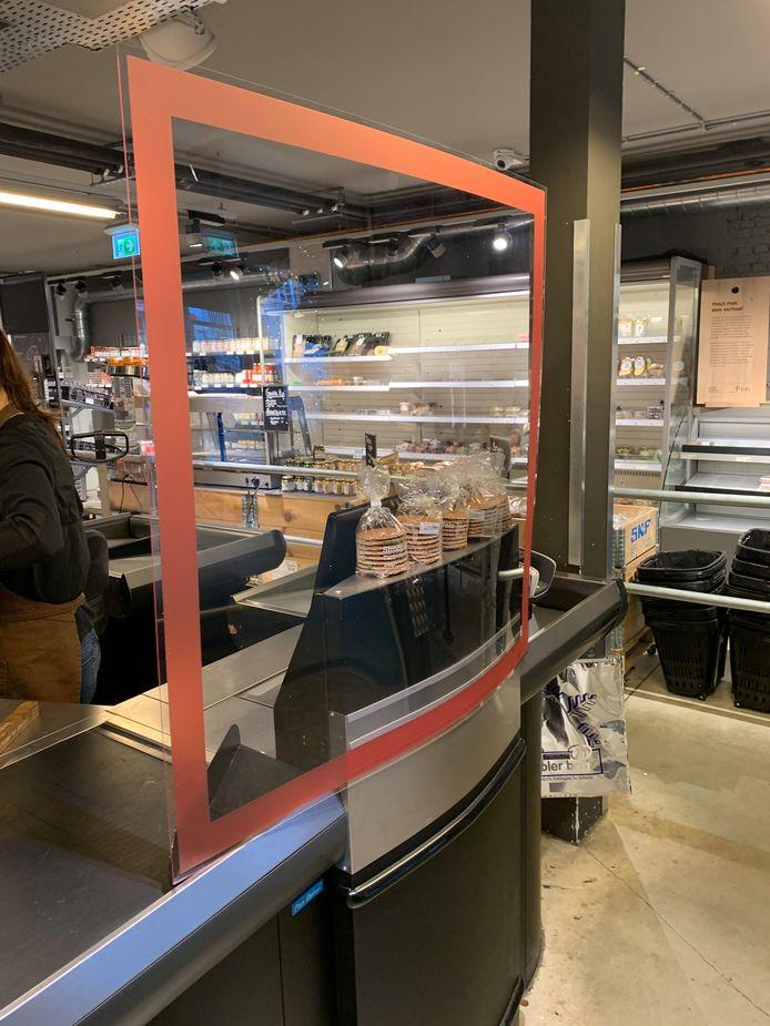 De kassaschermen van drukkerij Koopmans in een supermarkt.