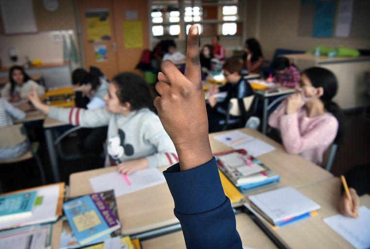 Leerlingen op een basisschool in Utrecht. Beeld Marcel van den Bergh / de Volkskrant