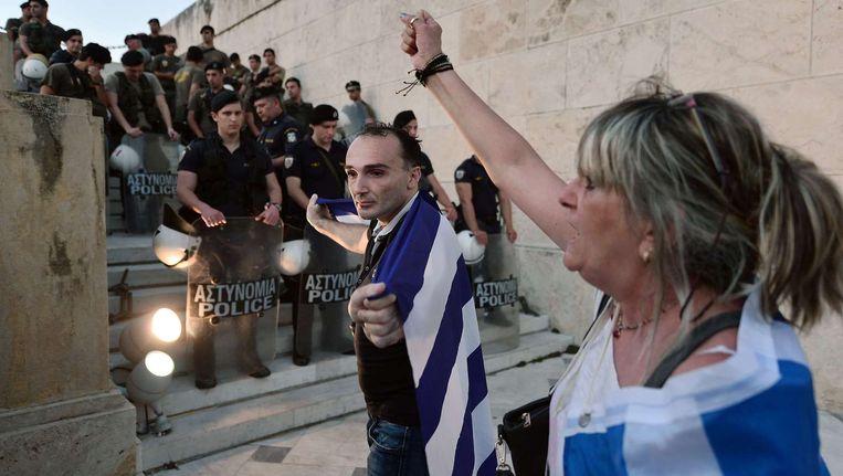 Demonstranten bij het Griekse parlement. Beeld epa