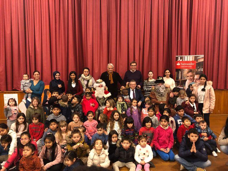De honderd kinderen genoten van het bezoek van de drie koningen.