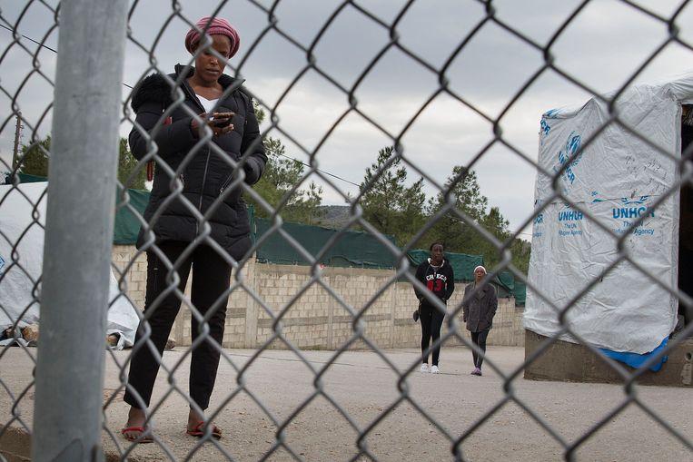 Vluchtelingen in het opvangkamp Moria op Lesbos. Beeld ANP