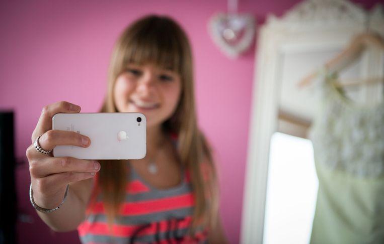 Je mag foto's maken met smartphone of met camera.