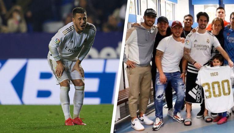 Rechts: Hazard ging gisteren na de zege mee op de overwinningsfoto van Real in de kleedkamer.