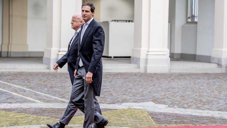 Ferdinand Grapperhaus en Wopke Hoekstra arriveren voor de beëdiging van de ministers van het kabinet Rutte III Beeld anp