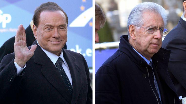 Berlusconi (links) en Monti arriveren in Brussel bij de bijeenkomst van de EVP Beeld REUTERS
