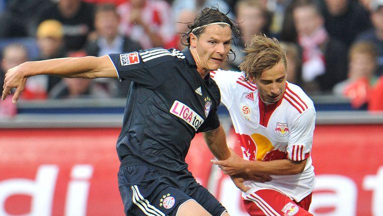 Dusan Svento, hier in duel met Rode Duivel Daniel Van Buyten, trekt volgend seizoen het shirt van FC Keulen aan.