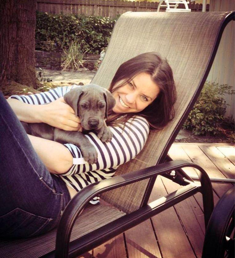 Brittany Maynard en haar hond Charlie, 2013. Beeld afp