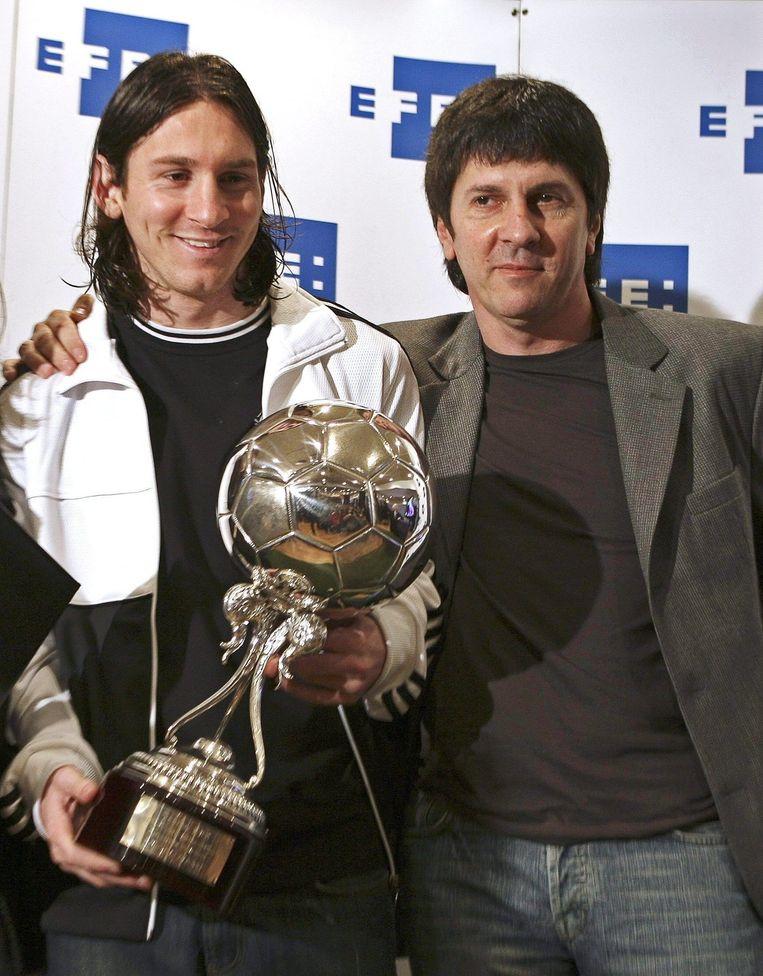 Vader en zoon Messi in 2007.