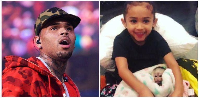 Chris Brown en zijn dochtertje Royalty met het aapje.
