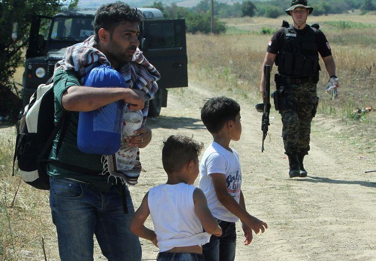 Syrische migranten aan de grens tussen Servië en Macedonië, gevlucht van het geweld in eigen land.