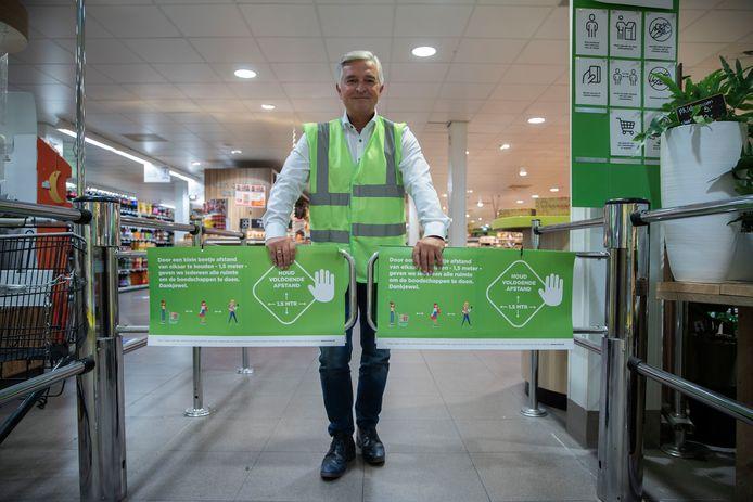 Wim van Doornmalen bij de entree van zijn Plus supermarkt in Mierlo.