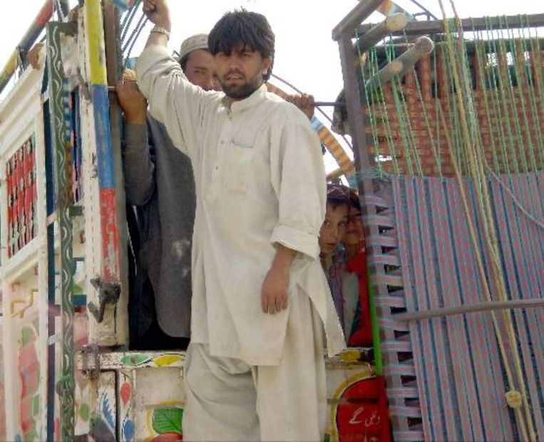 Pakistanen op de vlucht voor geweld. (EPA) Beeld