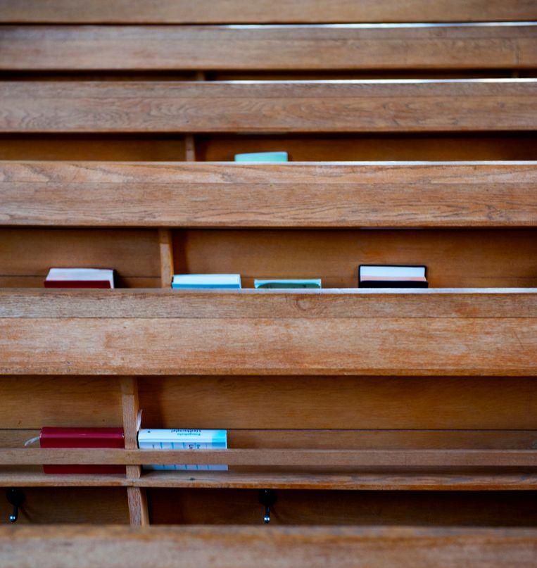 Bijbels en psalmboeken in de kerkbanken van een protestantse kerk. Beeld ANP XTRA