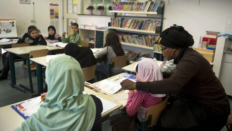 Leerlingen krijgen les op de islamitische basisschool Al-Siddieq in Zeeburg, Amsterdam. Beeld anp