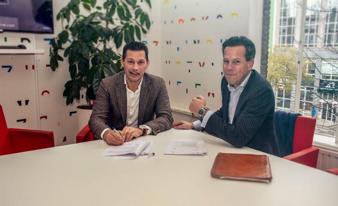 De ondertekening van de strategische samenwerking en miljoenenfinanciering van Helloprint met ABN AMRO. Links: financieel directeur Lennaert Koch van Helloprint.
