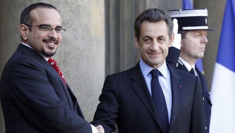 'Koning Hamad bin Isa al-Khalifa afgelopen februari met de Franse president Sarkozy Beeld
