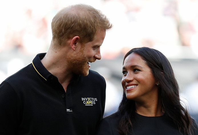 Meghan et Harry, lors du match opposant les Red Sox de Boston aux Yankees de New York, à Londres, le 29 juin 2019.