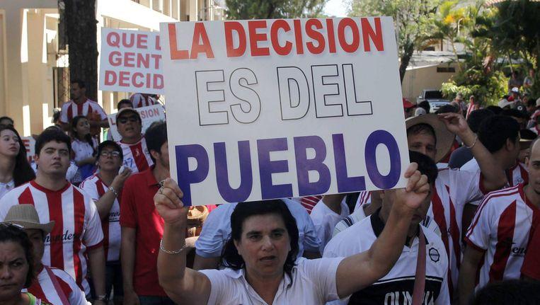Demonstratie voor referendum in Paraguay. Beeld epa